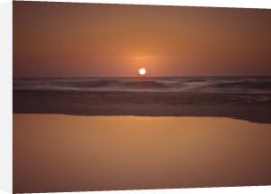 Suntset reflection in water, Palmachim Beach, Israel by Assaf Frank