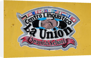 Spanish school sign, Antigua, Guatemala by Sergio Pitamitz