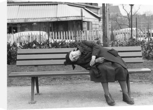 Bent lady on bench, Paris 1963 by Alan Scales