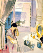 Woman reading at the table by Henri Matisse
