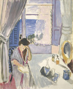 Woman reading at a Dressing Tabel late 1919
