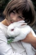 Girl with rabbit by Heinz Krimmer