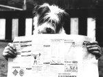 Dog reading a newspaper by Frantisek Dostal