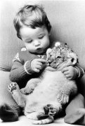 Little girl with tiger cub by John Drysdale