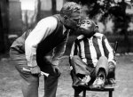 Man and chimp kissing by Anonymous