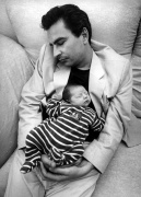 Infant and man sleeping by Gerd Pfeiffer
