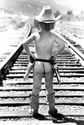 Naked cowboy ready to hold up the train by John Drysdale