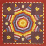 A Pieced And Appliqued Cotton Quilted Coverlet. Pennsylvania by American School