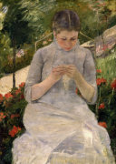 Young girl in the garden woman sewing