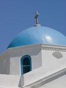 Greece, Cyclades, Mykonos Island. low angle view of church by Assaf Frank