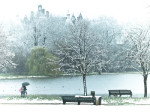 England, Man and woman walking by lake in Hyde park at winter by Assaf Frank