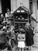 Shopkeeper placing toy ship in showcase, 1945 by Mirrorpix