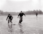 Ice hockey on frozen lake, 1954 by Mirrorpix