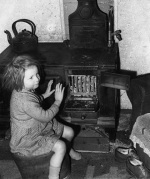 Girl sitting by oven, 1957 by Mirrorpix