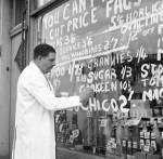 Grocer pricing goods, Forest Gate 1955 by Mirrorpix
