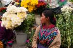 Flower-seller, Chichicastenango market, Guatemala by Sergio Pitamitz