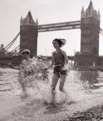 Children paddling on the foreshore below Tower Bridge
