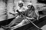Two women in rowing boat by Mirrorpix