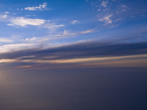 View of sunset through airplane window by Assaf Frank