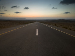 Road at Sunrise, Vanishing Point, Ramon Crater, Israel by Assaf Frank
