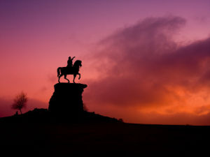 Statue of King George III sitting on horse at Windsor Great Park at dusk by Assaf Frank