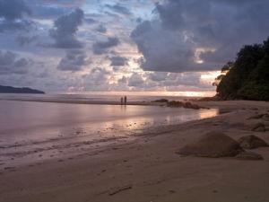 Stones on beach at dusk, Malaysia by Assaf Frank