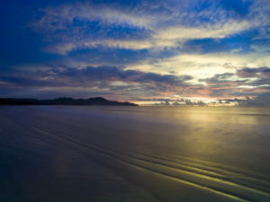 Beach with clouds at dusk, Malaysia by Assaf Frank