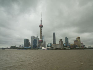 China, Shanghai, Skyscrapers by river by Assaf Frank