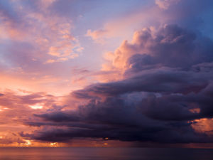 Clouds over sea at dusk, Malaysia by Assaf Frank