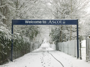 Welcome to Ascot sign board with trees covered in snow, Ascot, Berkshire UK by Assaf Frank