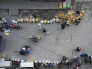 Guangxi Province, China, Elevated view of people in market by Assaf Frank