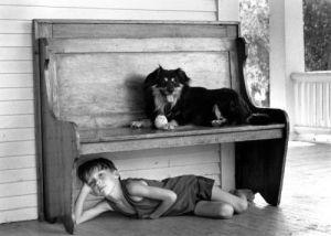 Little boy and his dog by David Hornback