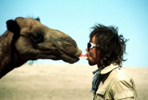 Man and camel sharing a piece of melon by Petra Gall Stas