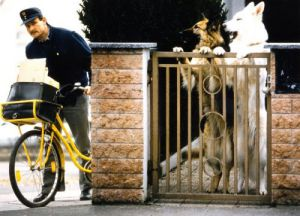 Postman and large dogs by Gerd Pfeiffer