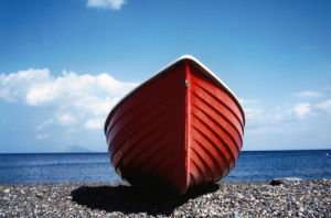 Red boat at Canneto, Italy by Heinz Krimmer