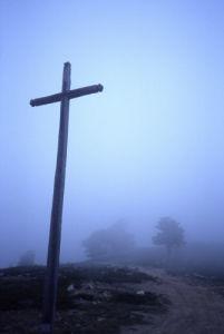 Cross in the foggy hills by Heinz Krimmer