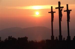 Three crucifixes at sunset by Berndt Fischer