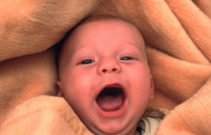 Laughing baby by Koch & Wolf