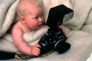 Baby with a camera by Koch & Wolf