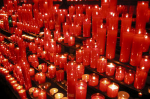 Red candles in a church by Rosseforp