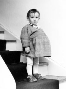 Girl standing on the stairs by Gerd Pfeiffer