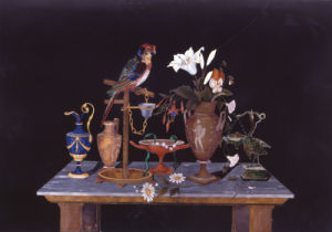 A Parrot On Its Perch On A Table by Christie's Images