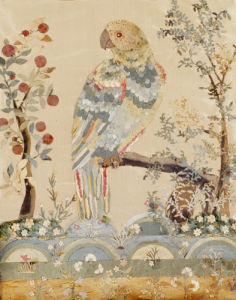 An Applique Picture Of A Parrot Perched In An Acacia Tree Above Hillocks by Christie's Images