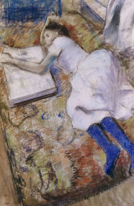 A Young Girl Stretched Out And Looking at An Album by Edgar Degas
