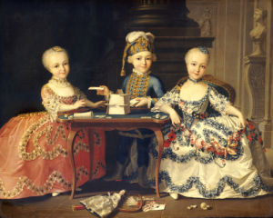 A Group Portrait Of A Boy In Ornate Blue Costume Building A House Of Cards by Christie's Images