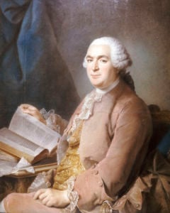 Portrait Of A Gentleman Seated At A Table With A Book by Maurice Quentin de la Tour