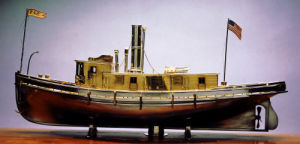 A Fine Silvered And Gilt-Metal Model Of A Tugboat by John Dean Benton