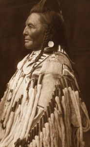 Shot In The Hand- Apsaroke by Edward S. Curtis