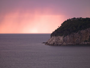 Island off the coast of Dalmatia at dusk by Assaf Frank