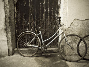 Bicycle standing by wall, Shanghai, china (Sepia) by Assaf Frank